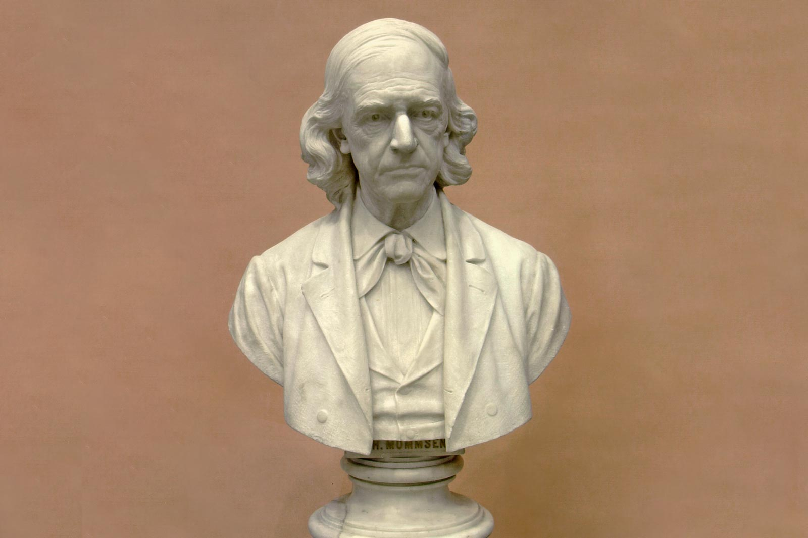 white marble bust of an older man, more precisely of Theodor Mommsen
