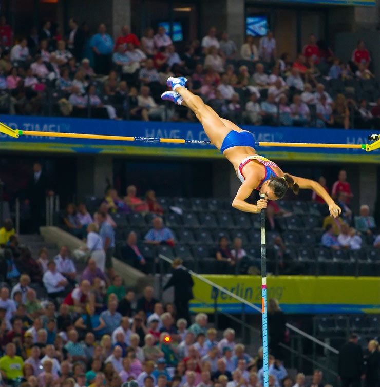 image of an athlete performing a pole vault