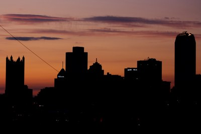photograph of the Pittsburgh skyline against the sunset