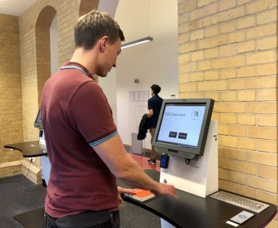 Self-checkout machines in the Campus Nord Branch Library